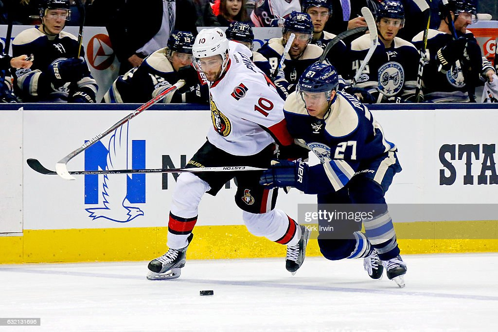 Ryan Murray #27 of the Columbus Blue Jackets and Tom Pyatt #10 of the Ottawa Senators battle for control of the puck during the third period on January 19, 2017 at Nationwide Arena in Columbus, Ohio. Ottawa defeated Columbus 2-0.