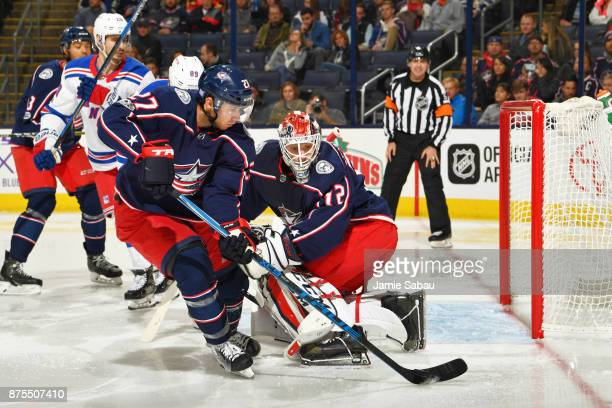 Ryan Murray of the Columbus Blue Jackets skates the puck away from goaltender Sergei Bobrovsky of the Columbus Blue Jackets during the second period...