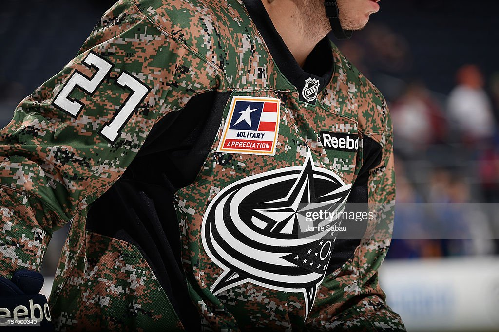 Ryan Murray #27 of the Columbus Blue Jackets sports a camouflage jersey during pre-game warmups for Military Appreciation Night before a game against the New York Islanders on November 9, 2013 at Nationwide Arena in Columbus, Ohio.