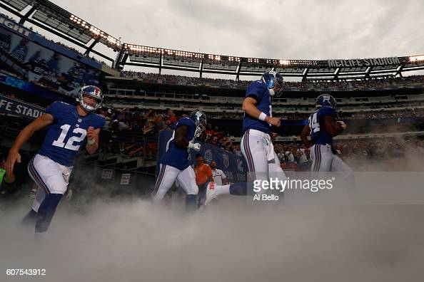Ryan Nassib quarterback Eli Manning Shane Vereen of the New York Giants and teammates take the field before playing against the New Orleans Saints at...