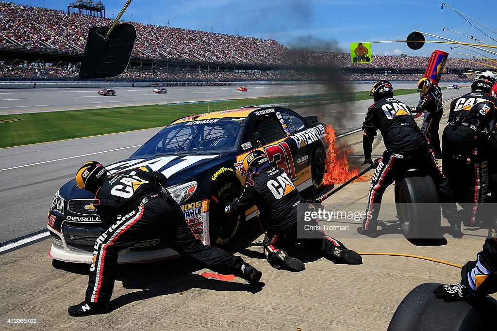 Ryan Newman, driver of the #31 Caterpillar Chevrolet, catches fire on pit road during the NASCAR Sprint Cup Series GEICO 500 at Talladega Superspeedway on May 3, 2015 in Talladega, Alabama.