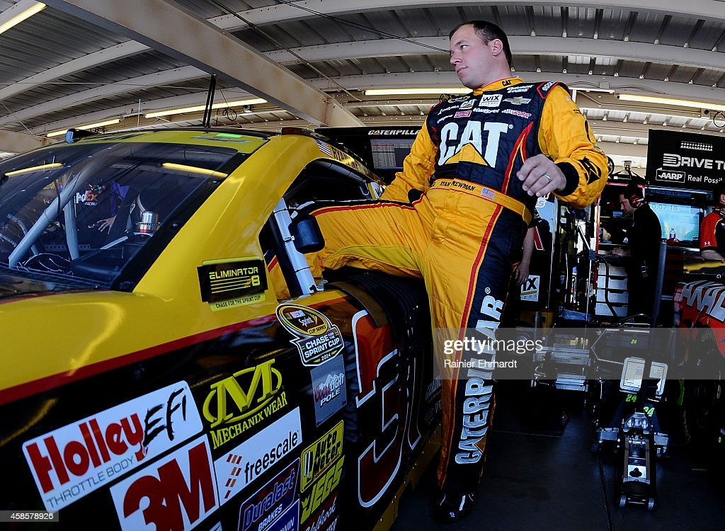 Ryan Newman driver of the Caterpillar Chevrolet climbs into his car during practice for the NASCAR Sprint Cup Series Quicken Loans Race for Heroes...