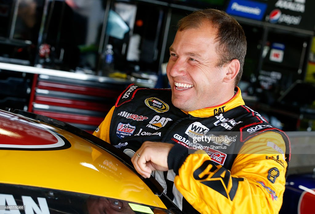 <a gi-track='captionPersonalityLinkClicked' href=/galleries/search?phrase=Ryan+Newman+-+Racerf%C3%B6rare&family=editorial&specificpeople=12773547 ng-click='$event.stopPropagation()'>Ryan Newman</a>, driver of the #31 Caterpillar Chevrolet, climbs into his car during practice for the NASCAR Sprint Cup Series Pure Michigan 400 at Michigan International Speedway on August 15, 2015 in Brooklyn, Michigan.