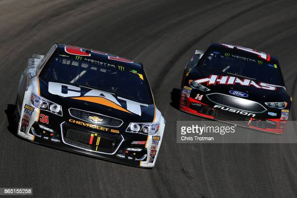 Ryan Newman driver of the Caterpillar Chevrolet leads Clint Bowyer driver of the Haas Automation Ford during the Monster Energy NASCAR Cup Series...