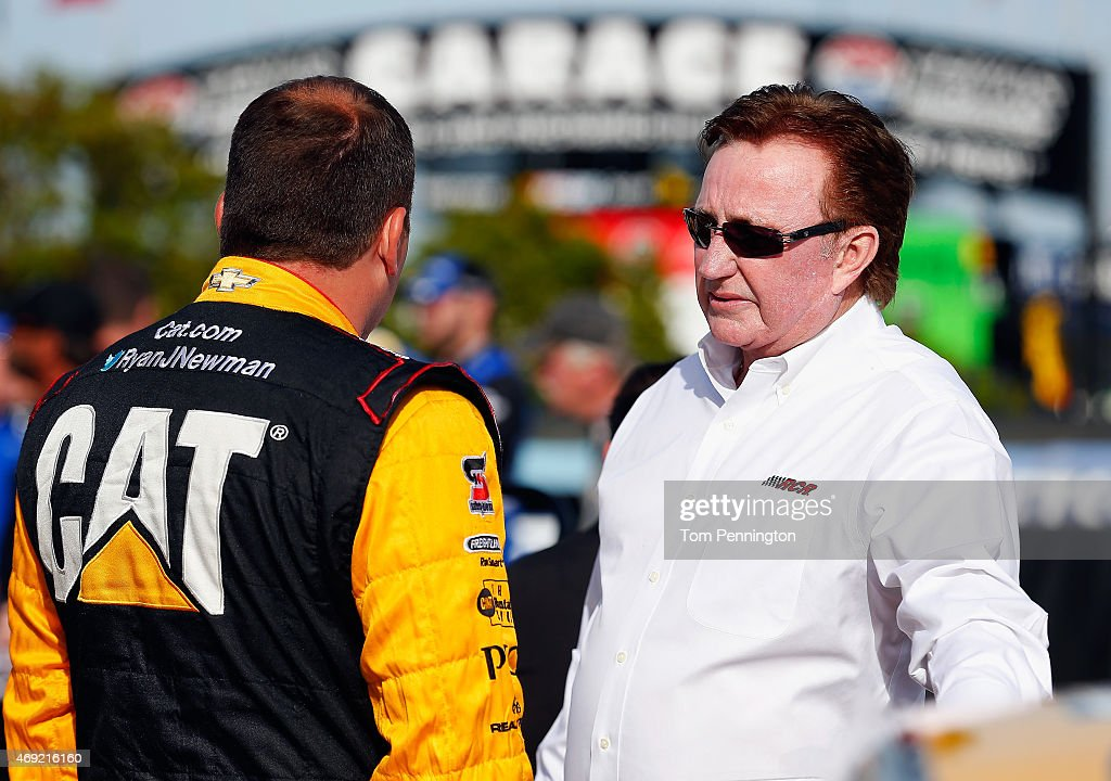 Ryan Newman driver of the Caterpillar Chevrolet left talks with team owner Richard Childress on the grid prior to qualifying for the NASCAR Sprint...