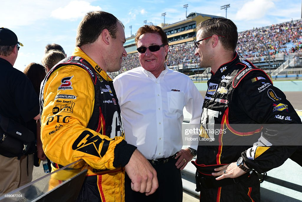 Ryan Newman driver of the Caterpillar Chevrolet speaks with team owner Richard Childress and crew chief Luke Lambert before the NASCAR Sprint Cup...