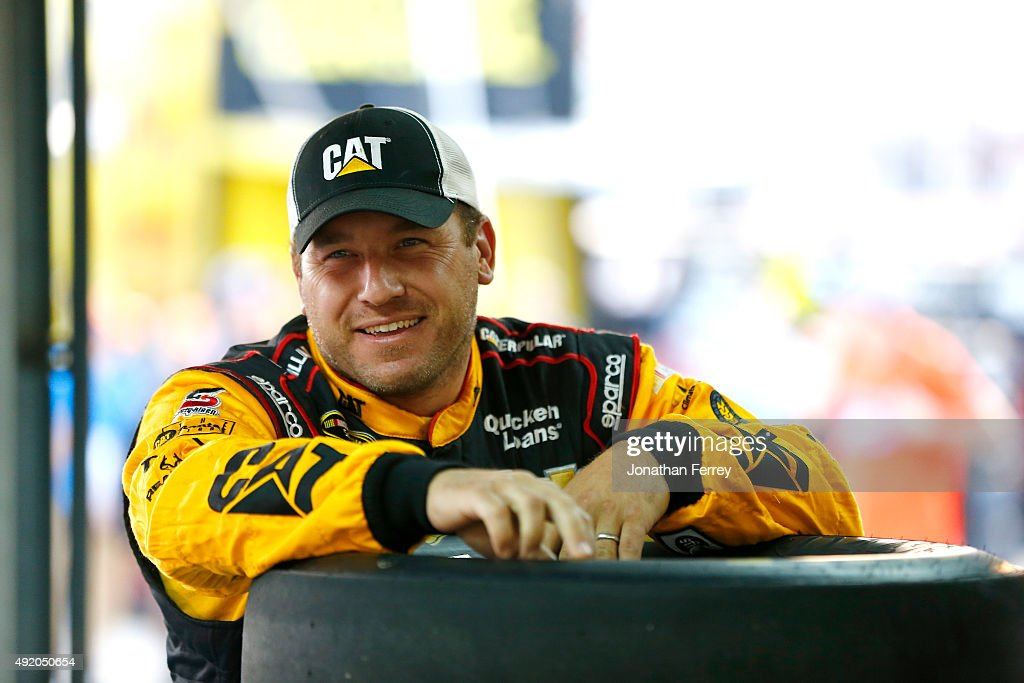 <a gi-track='captionPersonalityLinkClicked' href=/galleries/search?phrase=Ryan+Newman+-+Racerf%C3%B6rare&family=editorial&specificpeople=12773547 ng-click='$event.stopPropagation()'>Ryan Newman</a>, driver of the #31 Caterpillar Chevrolet, stands in the garage area during practice for the NASCAR Sprint Cup Series Bank of America 500 at Charlotte Motor Speedway on October 9, 2015 in Charlotte, North Carolina.