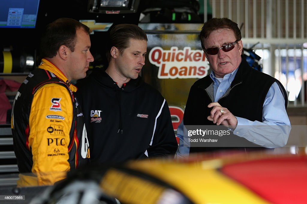 Ryan Newman driver of the Caterpillar Chevrolet talks with team owner Richard Childress during practice for the NASCAR Sprint Cup Series Auto Club...
