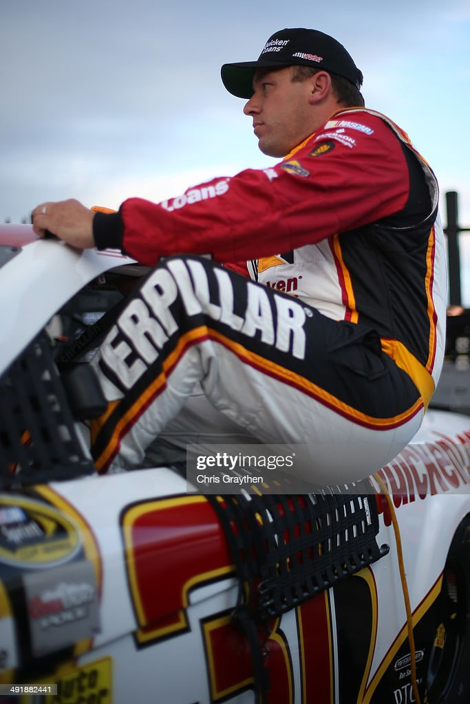 Ryan Newman driver of the CAT/Quicken Loans Chevrolet climbs into his car during qualifying for the NASCAR Sprint Cup Series Sprint AllStar Race at...