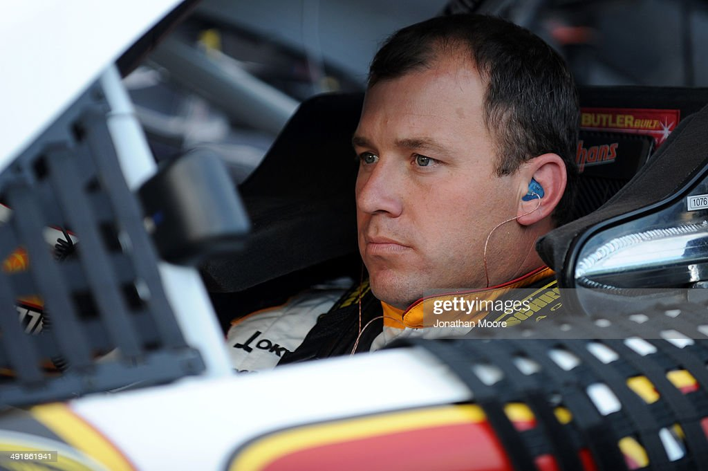 Ryan Newman driver of the CAT/Quicken Loans Chevrolet sits in his car during qualifying for the NASCAR Sprint Cup Series Sprint AllStar Race at...