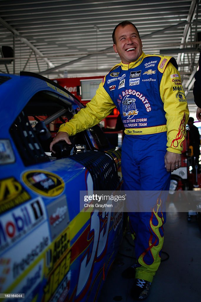 Ryan Newman, driver of the #39 Code 3 Associates Chevrolet, stands in the garage area during practice for the NASCAR Sprint Cup Series 13th Annual Hollywood Casino 400 at Kansas Speedway on October 5, 2013 in Kansas City, Kansas.
