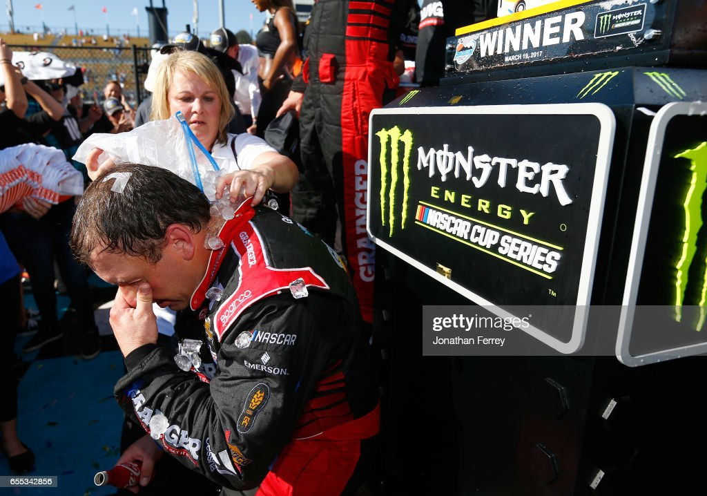 Ryan Newman, driver of the #31 Grainger Chevrolet, gets cooled down with ice and water in victory lane after winning the Monster Energy NASCAR Cup Series Camping World 500 at Phoenix International Raceway on March 19, 2017 in Avondale, Arizona.