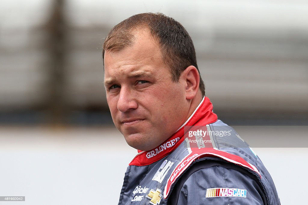 <a gi-track='captionPersonalityLinkClicked' href=/galleries/search?phrase=Ryan+Newman+-+Racerf%C3%B6rare&family=editorial&specificpeople=12773547 ng-click='$event.stopPropagation()'>Ryan Newman</a>, driver of the #31 Grainger Chevrolet, stands on the grid during qualifying for the NASCAR Sprint Cup Series Crown Royal Presents the Jeff Kyle 400 at the Brickyard at Indianapolis Motor Speedway on July 25, 2015 in Indianapolis, Indiana.