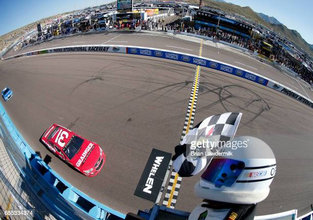 Ryan Newman driver of the Grainger Chevrolet takes the checkered flag to win the Monster Energy NASCAR Cup Series Camping World 500 at Phoenix...