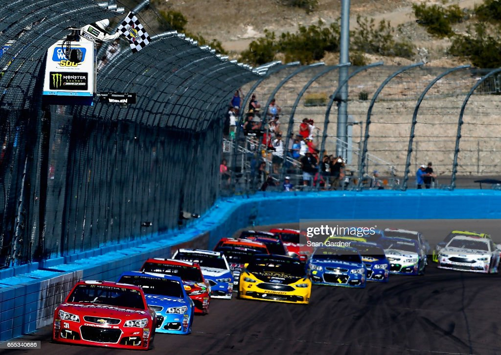 Ryan Newman, driver of the #31 Grainger Chevrolet, takes the checkered flag to win the Monster Energy NASCAR Cup Series Camping World 500 at Phoenix International Raceway on March 19, 2017 in Avondale, Arizona.