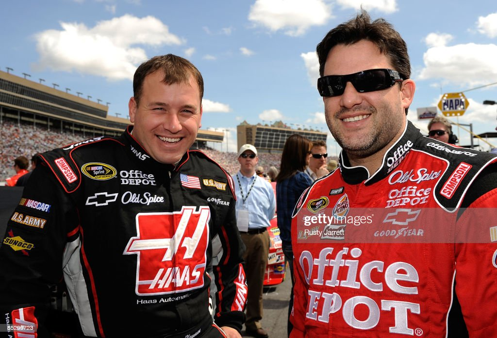 Ryan Newman, driver of the #39 Haas Automation Chevrolet shares a laugh with his car owner and driver of the #14 Office Depot/Old Spice Chevrolet, <a gi-track='captionPersonalityLinkClicked' href=/galleries/search?phrase=Tony+Stewart+-+Racerf%C3%B6rare&family=editorial&specificpeople=201686 ng-click='$event.stopPropagation()'>Tony Stewart</a> prior to the start of the NASCAR Sprint Cup Series Kobalt Tools 500 at the Atlanta Motor Speedway on March 8, 2009 in Hampton, Georgia.