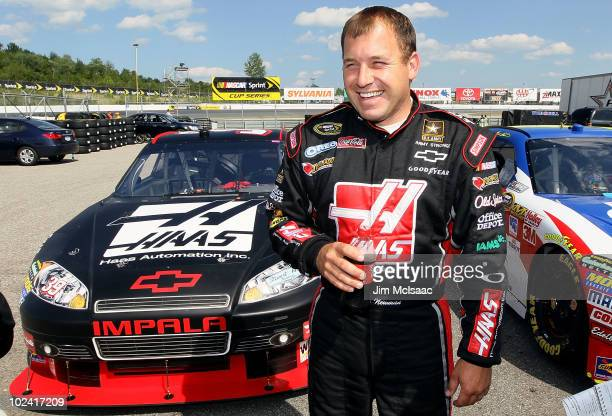 Ryan Newman driver of the Haas Automation Chevrolet stands in the garage area after qualifying for the NASCAR Sprint Cup Series LENOX Industrial...