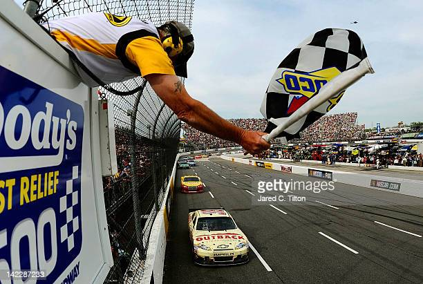 Ryan Newman driver of the Outback Steak House Chevrolet races to the checkered flag to win the NASCAR Sprint Cup Series Goody's Fast Relief 500 at...