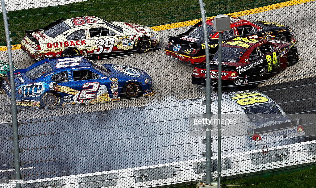 Ryan Newman driver of the Outback Steak House Chevrolet steers low to avoid the incident between Clint Bowyer driver of the 5hour Energy Toyota...
