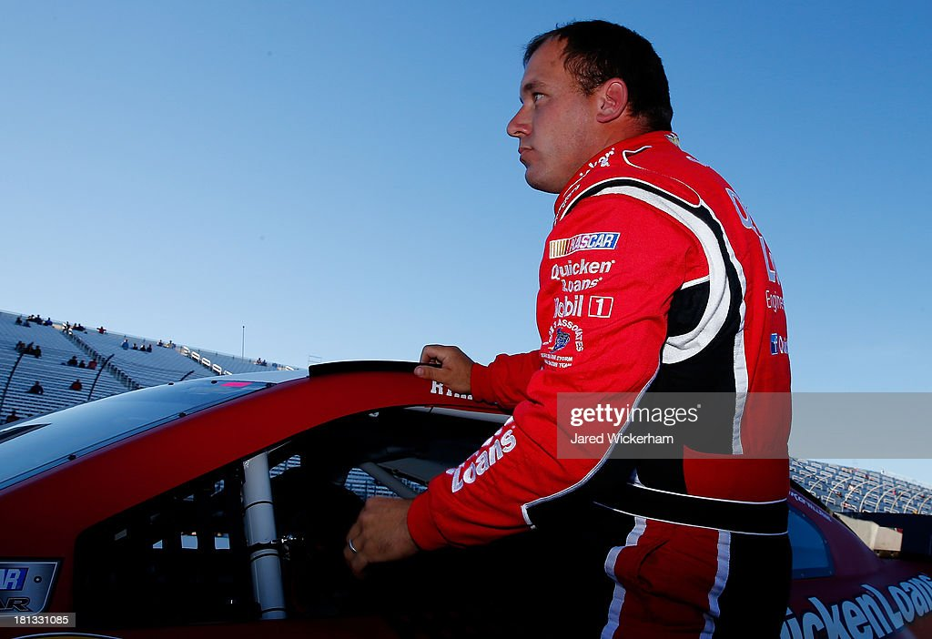 Ryan Newman, driver of the #39 Quicken Loans Chevrolet, climbs from his car after qualifying for the NASCAR Sprint Cup Series Sylvania 300 at New Hampshire Motor Speedway on September 20, 2013 in Loudon, New Hampshire.