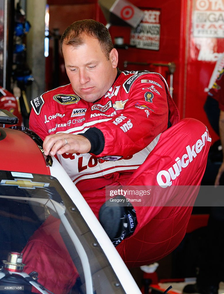 Ryan Newman, driver of the #31 Quicken Loans Chevrolet, climbs into his car in the garage area during practice for the NASCAR Sprint Cup Series Quicken Loans 400 at Michigan International Speedway on June 14, 2014 in Brooklyn, Michigan.