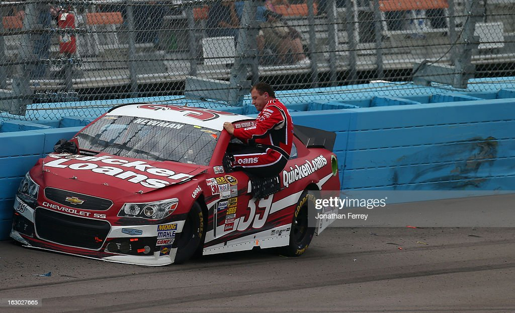 Ryan Newman driver of the Quicken Loans Chevrolet climbs ut of his car and walks across the track during the NASCAR Sprint Cup Series Subway Fresh...