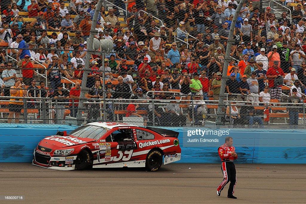 Ryan Newman driver of the Quicken Loans Chevrolet jumps out of his car and walks across the track during the NASCAR Sprint Cup Series Subway Fresh...