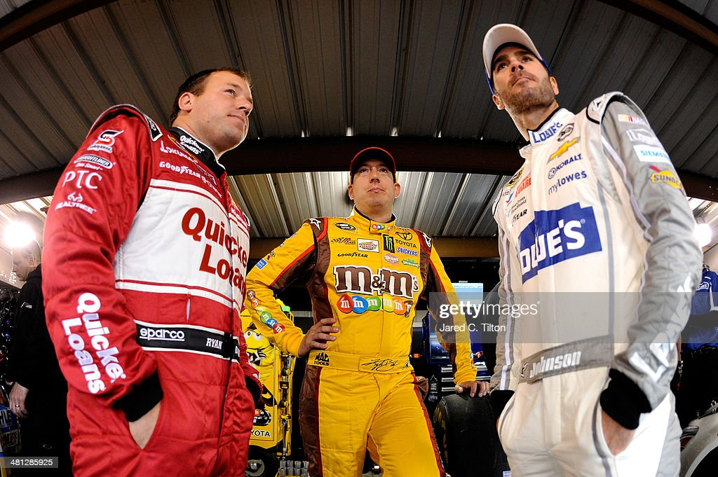 Ryan Newman, driver of the #31 Quicken Loans Chevrolet, <a gi-track='captionPersonalityLinkClicked' href=/galleries/search?phrase=Kyle+Busch&family=editorial&specificpeople=211123 ng-click='$event.stopPropagation()'>Kyle Busch</a>, driver of the #18 M&M's Toyota, and Jimmie Johnson, driver of the #48 Lowe's Chevrolet, talk in the garage area during a rain delay in practice for the NASCAR Sprint Cup Series STP 500 at Martinsville Speedway on March 29, 2014 in Martinsville, Virginia.