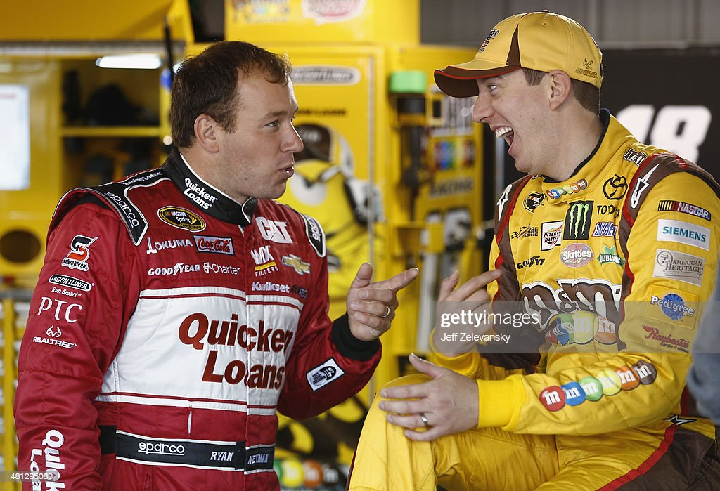 Ryan Newman, driver of the #31 Quicken Loans Chevrolet, left talks with <a gi-track='captionPersonalityLinkClicked' href=/galleries/search?phrase=Kyle+Busch&family=editorial&specificpeople=211123 ng-click='$event.stopPropagation()'>Kyle Busch</a>, driver of the #18 M&M's Toyota, in the garage area during a rain delay in practice for the NASCAR Sprint Cup Series STP 500 at Martinsville Speedway on March 29, 2014 in Martinsville, Virginia.