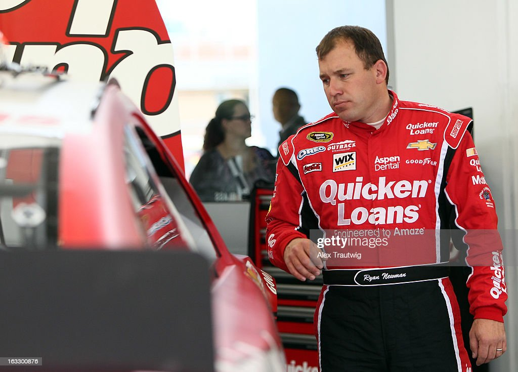 Ryan Newman, driver of the #39 Quicken Loans Chevrolet, looks at his car during NASCAR Sprint Cup Series testing at Las Vegas Motor Speedway on March 7, 2013 in Las Vegas, Nevada.