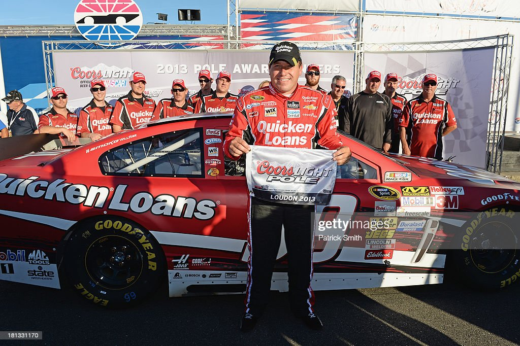 Ryan Newman, driver of the #39 Quicken Loans Chevrolet, poses in Victory Lane after qualifying for the pole position in the NASCAR Sprint Cup Series Sylvania 300 at New Hampshire Motor Speedway on September 20, 2013 in Loudon, New Hampshire.