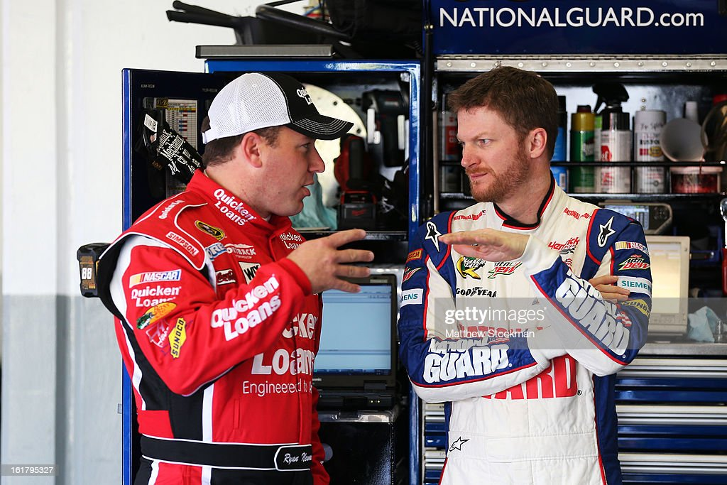 Ryan Newman, driver of the #39 Quicken Loans Chevrolet, speaks with Dale Earnhardt Jr., driver of the #88 National Guard Chevrolet, during practice for the NASCAR Sprint Cup Series Daytona 500 at Daytona International Speedway on February 16, 2013 in Daytona Beach, Florida