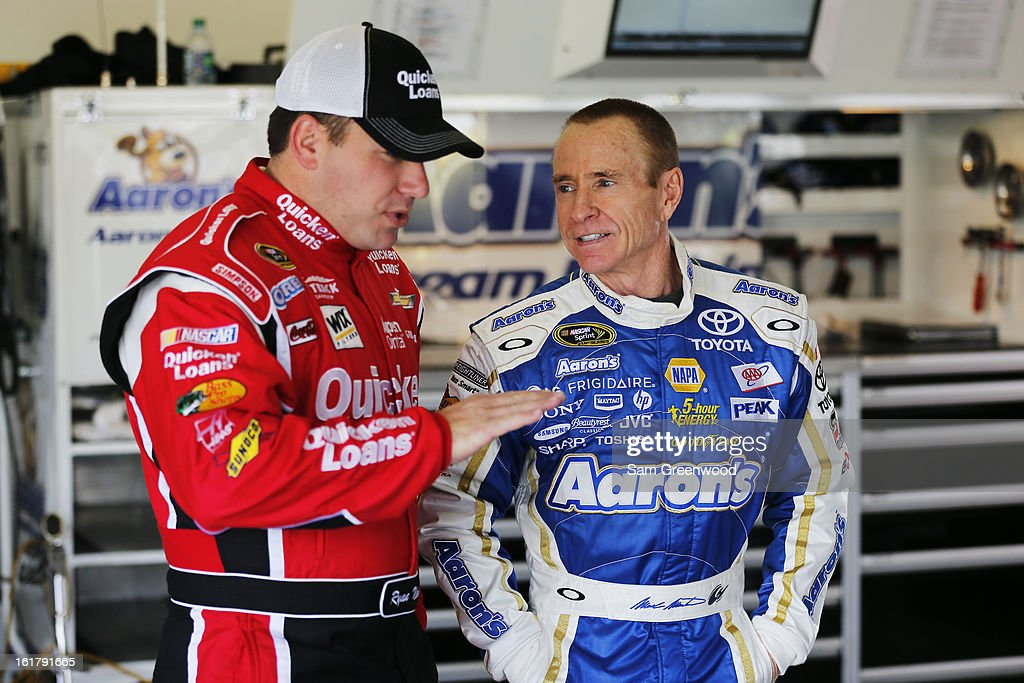 Ryan Newman, driver of the #39 Quicken Loans Chevrolet, speaks with Mark Martin, driver of the #55 Aaron's Dream Machine Toyota, before practice for the NASCAR Sprint Cup Series Daytona 500 at Daytona International Speedway on February 16, 2013 in Daytona Beach, Florida