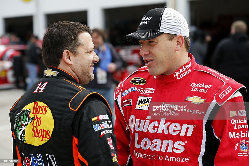 Ryan Newman, driver of the #39 Quicken Loans Chevrolet, speaks with Tony Stewart, driver of the #14 Bass Pro Shops/Mobil 1 Chevrolet, during practice for the NASCAR Sprint Cup Series Daytona 500 at Daytona International Speedway on February 16, 2013 in Daytona Beach, Florida