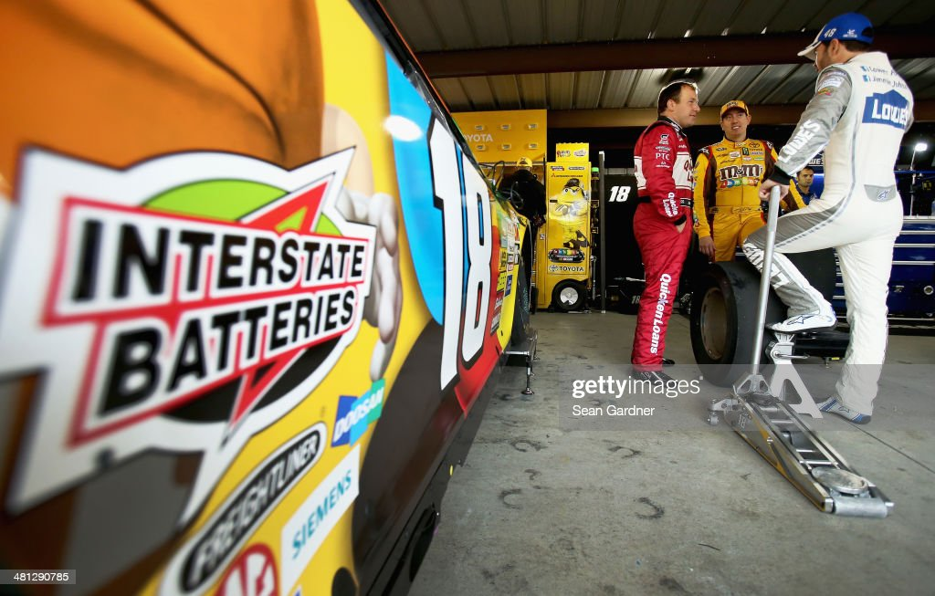 Ryan Newman, driver of the #31 Quicken Loans Chevrolet, talks with <a gi-track='captionPersonalityLinkClicked' href=/galleries/search?phrase=Kyle+Busch&family=editorial&specificpeople=211123 ng-click='$event.stopPropagation()'>Kyle Busch</a>, driver of the #18 M&M's Toyota, and Jimmie Johnson, driver of the #48 Lowe's Chevrolet, in the garage area during practice for the NASCAR Sprint Cup Series STP 500 at Martinsville Speedway on March 29, 2014 in Martinsville, Virginia.