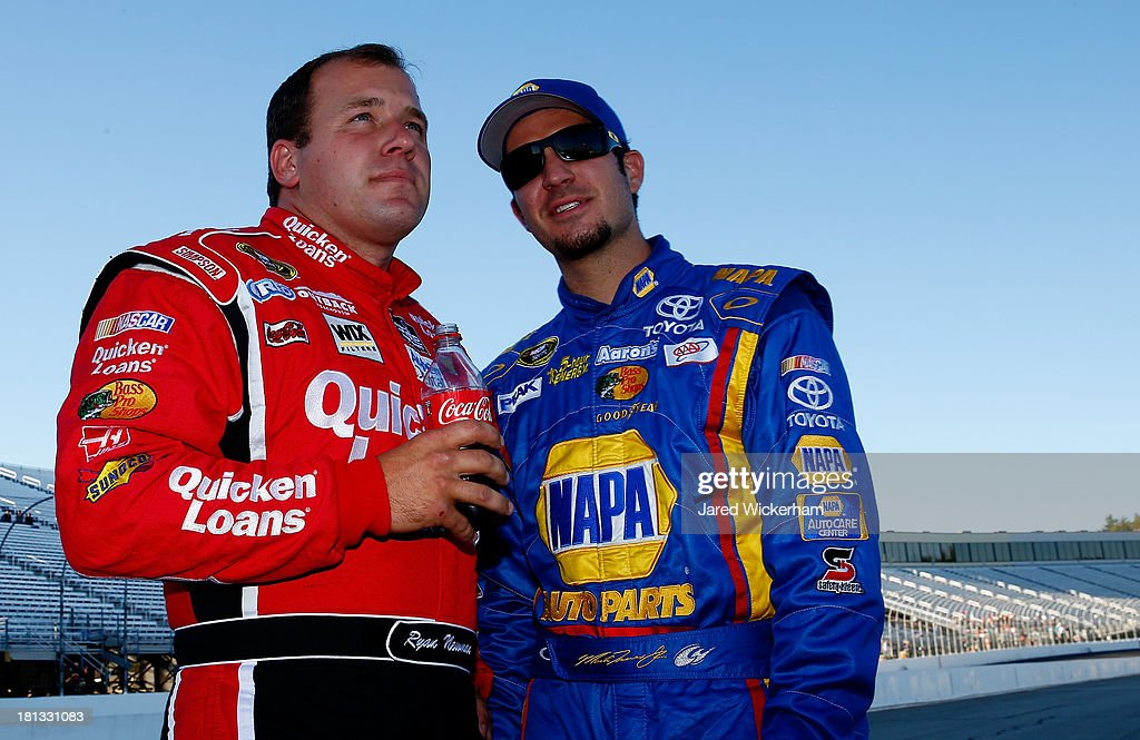 Ryan Newman, driver of the #39 Quicken Loans Chevrolet, talks with <a gi-track='captionPersonalityLinkClicked' href=/galleries/search?phrase=Martin+Truex+Jr.&family=editorial&specificpeople=184514 ng-click='$event.stopPropagation()'>Martin Truex Jr.</a>, driver of the #56 NAPA Auto Parts Toyota, on the grid during qualifying for the NASCAR Sprint Cup Series Sylvania 300 at New Hampshire Motor Speedway on September 20, 2013 in Loudon, New Hampshire.