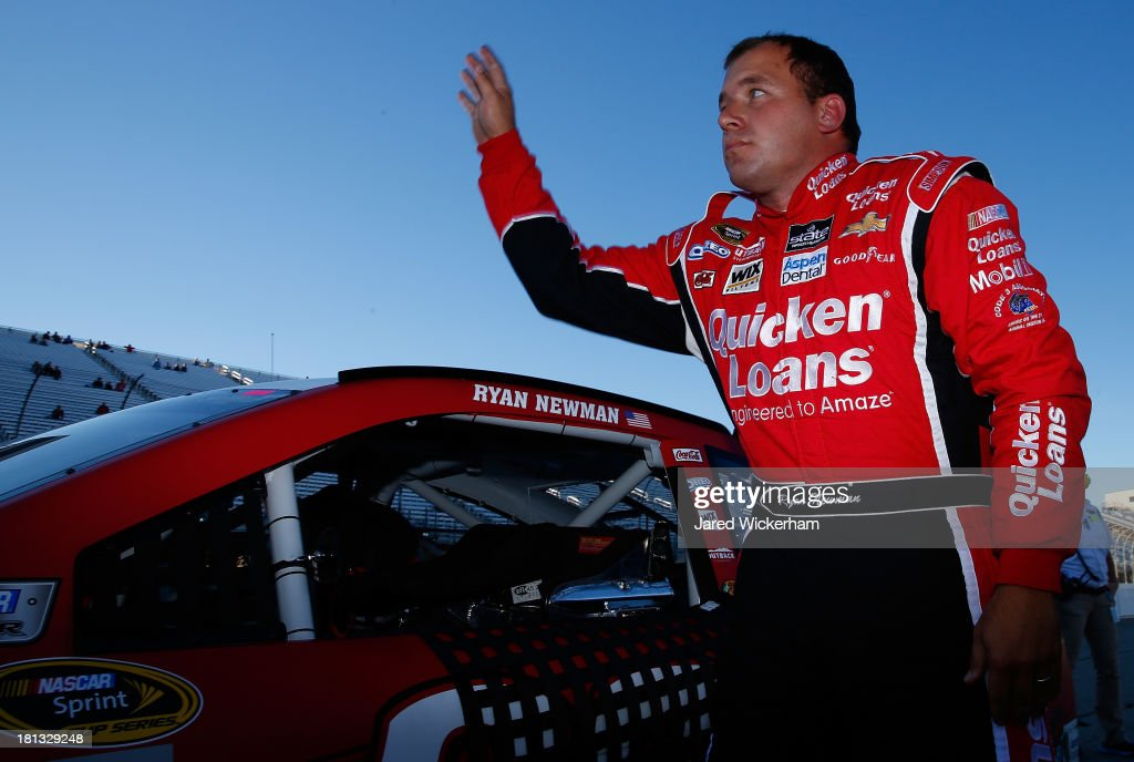 Ryan Newman, driver of the #39 Quicken Loans Chevrolet, waves to fans after qualifying for the NASCAR Sprint Cup Series Sylvania 300 at New Hampshire Motor Speedway on September 20, 2013 in Loudon, New Hampshire.