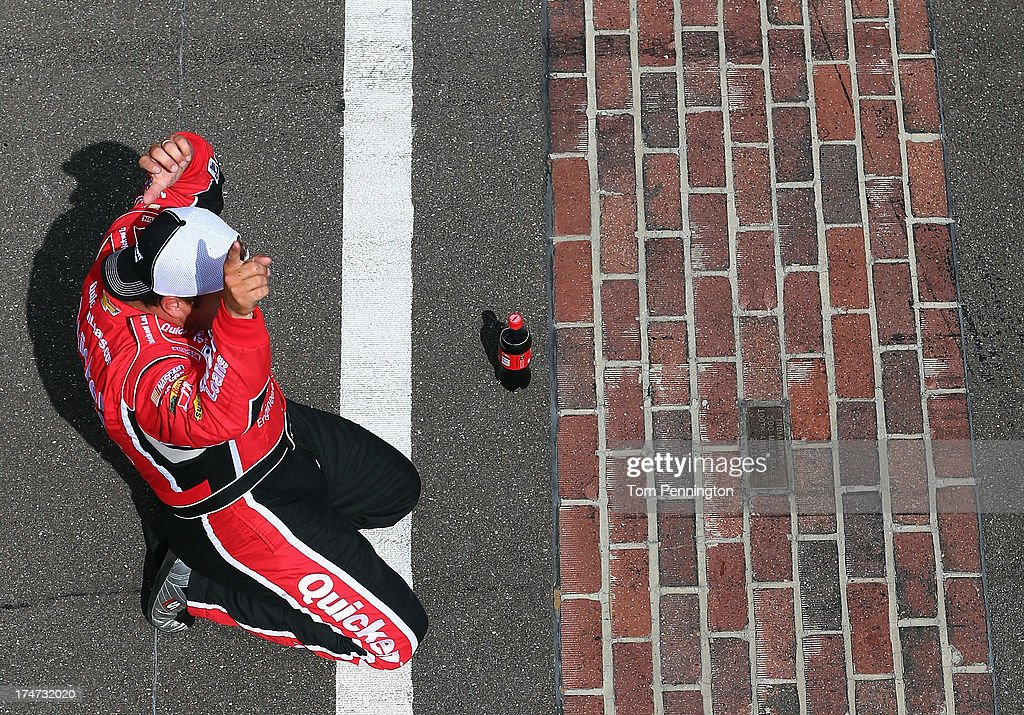 Ryan Newman, driver of the #39 Quicken Loans/The Smurfs Chevrolet, celebrates after winning the NASCAR Sprint Cup Series Samuel Deeds 400 At The Brickyard at Indianapolis Motor Speedway on July 28, 2013 in Indianapolis, Indiana.