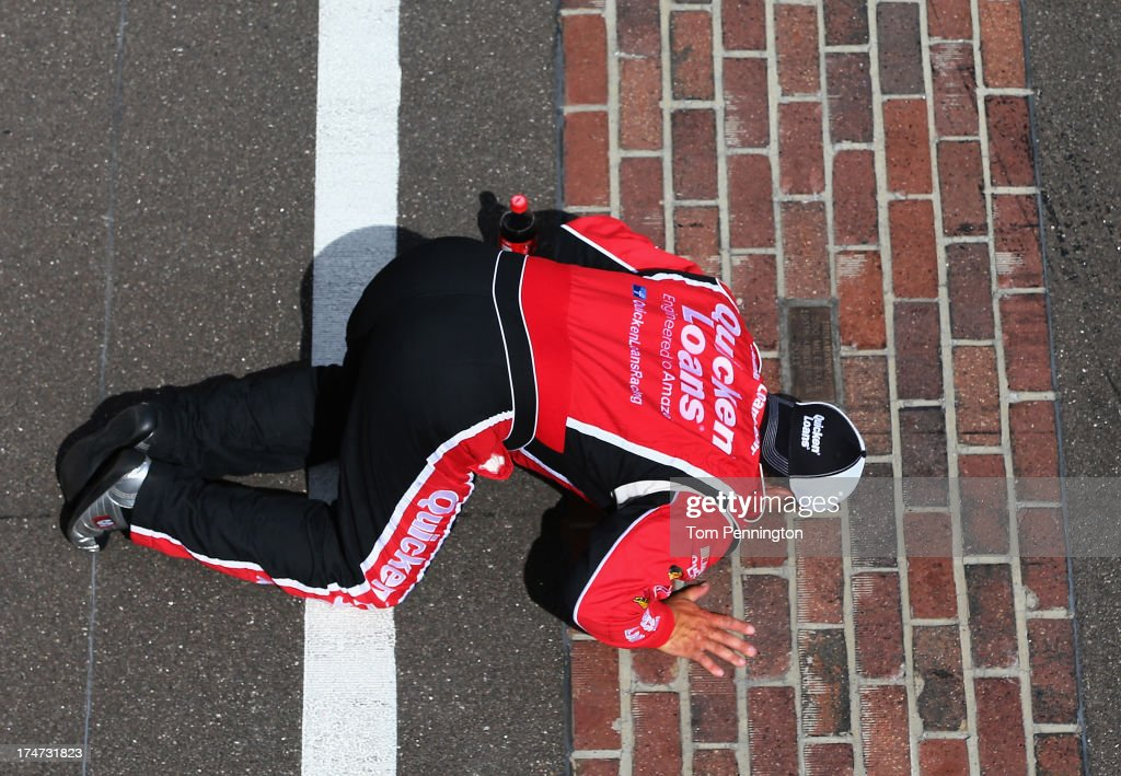 Ryan Newman, driver of the #39 Quicken Loans/The Smurfs Chevrolet, kisses the bricks after winning the NASCAR Sprint Cup Series Samuel Deeds 400 At The Brickyard at Indianapolis Motor Speedway on July 28, 2013 in Indianapolis, Indiana.