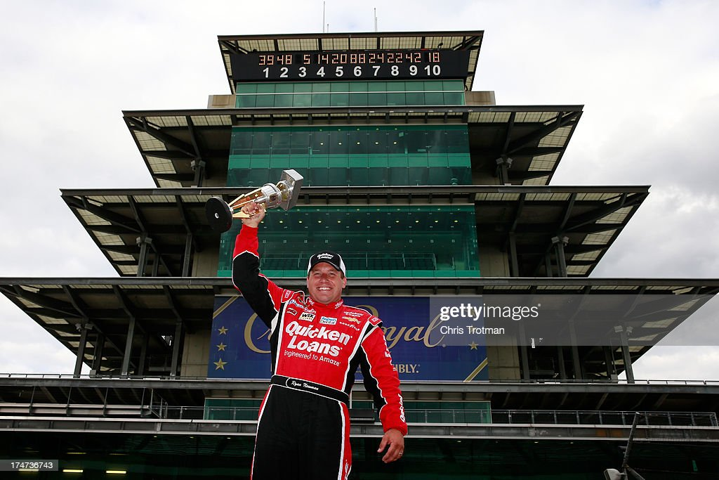 Ryan Newman, driver of the #39 Quicken Loans/The Smurfs Chevrolet, poses for a photo after winning the NASCAR Sprint Cup Series Samuel Deeds 400 At The Brickyard at Indianapolis Motor Speedway on July 28, 2013 in Indianapolis, Indiana.