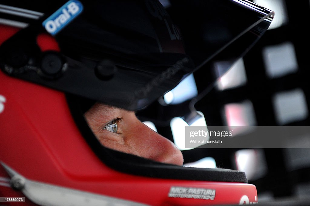 Ryan Newman, driver of the #31 QuickenLoansBillionDollarBracketChallenge Chevrolet, sits in his car during practice for the NASCAR Sprint Cup Series Food City 500 at Bristol Motor Speedway on March 15, 2014 in Bristol, Tennessee.