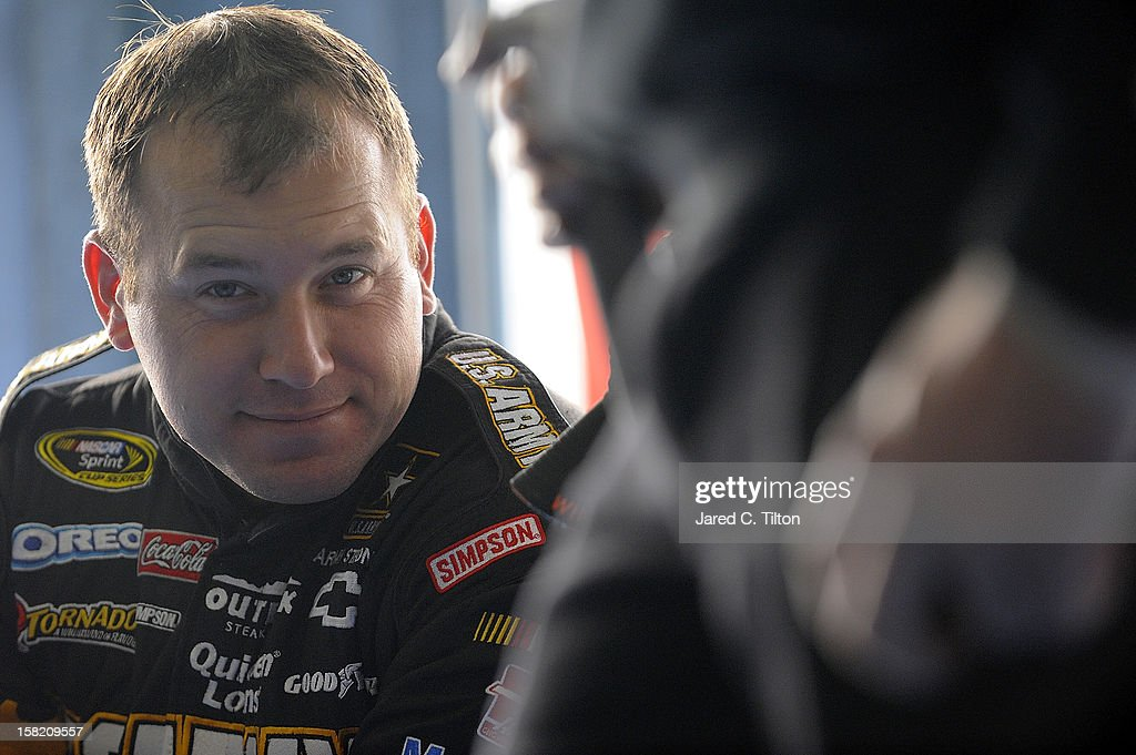 Ryan Newman, driver of the Stewart-Haas Racing Chevrolet, looks on in the garage area during testing at Charlotte Motor Speedway on December 11, 2012 in Concord, North Carolina.