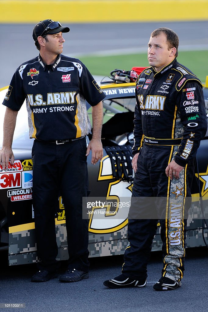 Ryan Newman (R), driver of the #39 U.S.Army Chevrolet, stands on the grid with a team member during qualifying for the NASCAR Sprint Cup Series Coca-Cola 600 at Charlotte Motor Speedway on May 27, 2010 in Concord, North Carolina.