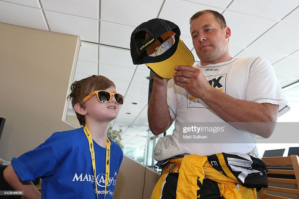 <a gi-track='captionPersonalityLinkClicked' href=/galleries/search?phrase=Ryan+Newman+-+Race+Car+Driver&family=editorial&specificpeople=12773547 ng-click='$event.stopPropagation()'>Ryan Newman</a>, driver of the #31 WIX Filters Chevrolet, speaks to former Make A Wish participants and their families prior to practice for the NASCAR Sprint Cup Series Toyota/Save Mart 350 at Sonoma Raceway on June 24, 2016 in Sonoma, California.