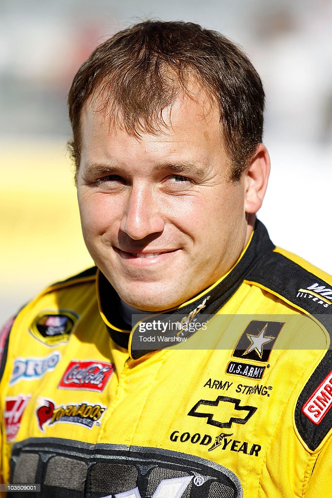 Ryan Newman driver of the Wix Filters Chevrolet stands next to his car on the grid during qualifying for the NASCAR Sprint Cup Series IRWIN Tools...