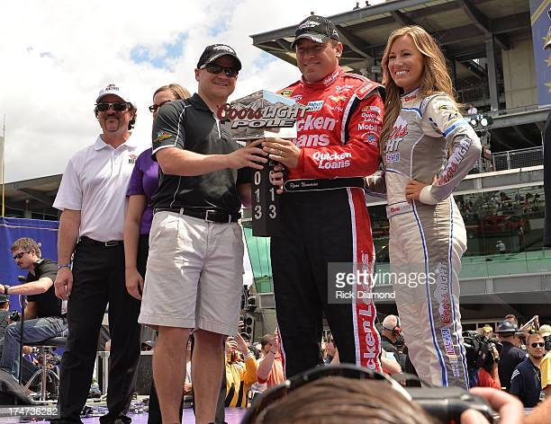 Ryan Newman winner of the Coors Light Pole with Big Machine Records CEO/President Scott Borchetta and Samuel Deeds at the Brickyard 400 Presented By...