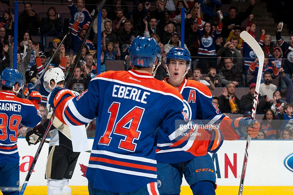 <a gi-track='captionPersonalityLinkClicked' href=/galleries/search?phrase=Ryan+Nugent-Hopkins&family=editorial&specificpeople=7144190 ng-click='$event.stopPropagation()'>Ryan Nugent-Hopkins</a> #93 and <a gi-track='captionPersonalityLinkClicked' href=/galleries/search?phrase=Jordan+Eberle&family=editorial&specificpeople=4898161 ng-click='$event.stopPropagation()'>Jordan Eberle</a> #14 of the Edmonton Oilers celebrate after a goal in a game against the Pittsburgh Penguins on January 10, 2014 at Rexall Place in Edmonton, Alberta, Canada.