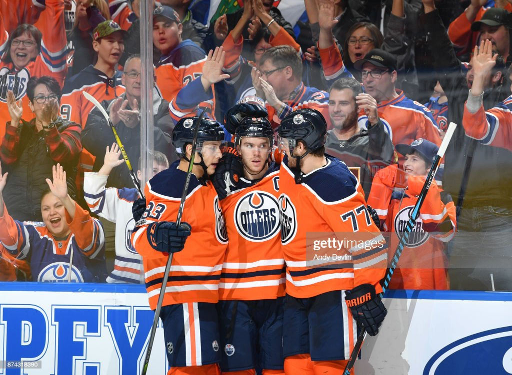 Ryan Nugent-Hopkins #93, Connor McDavid #97 and Oscar Klefbom #77 of the Edmonton Oilers celebrate after a goal during the game against the Vegas Golden Knights on November 14, 2017 at Rogers Place in Edmonton, Alberta, Canada.