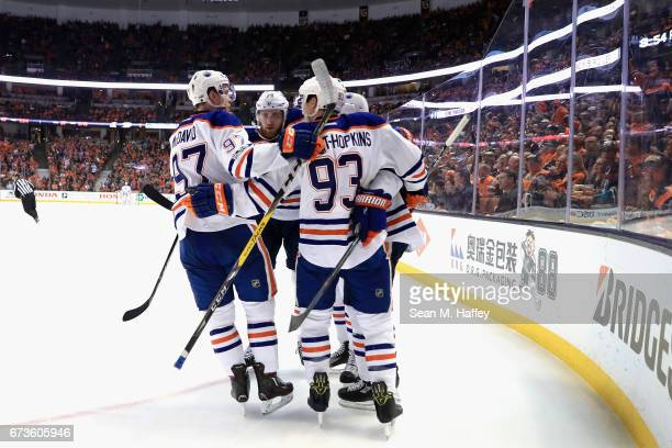 Ryan NugentHopkins Connor McDavid congratulate Mark Letestu of the Edmonton Oilers after scoring in the second period in Game One of the Western...
