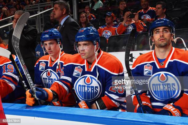 Ryan NugentHopkins Iiro Pakarinen and Jordan Eberle of the Edmonton Oilers watch the action during the game against the Arizona Coyotes on February...
